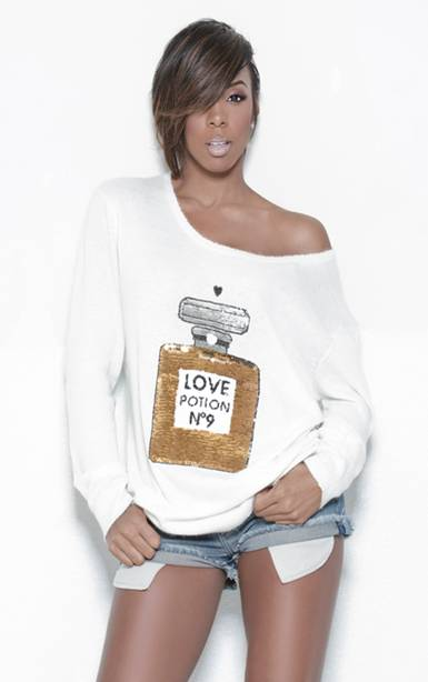 kelly rowland 2011 photoshoot. Kelly Rowland looks cute and